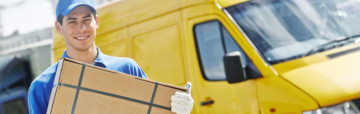 Picture of delivery man carrying parcel near yellow delivery van - a typical customer for GK Taxation Services