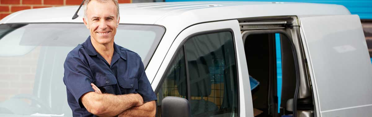 Photo of tradesman standing by an open van. Tradesmen are typical of the type of self-employed person who uses the services of GK Taxation Services